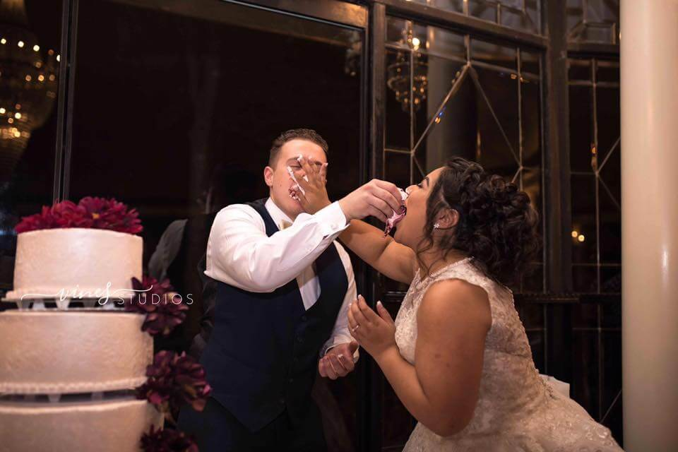 Sociably Yours - Bride and Groom Feeding Each other Cake